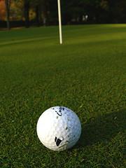 A golf ball and a hole.