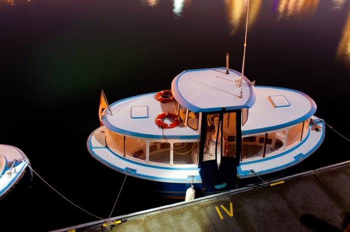 Small boat at night marina