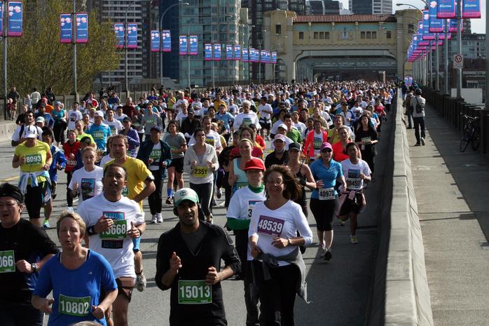 Athletes Running Across the Bridge Vancouver SunRun 2013