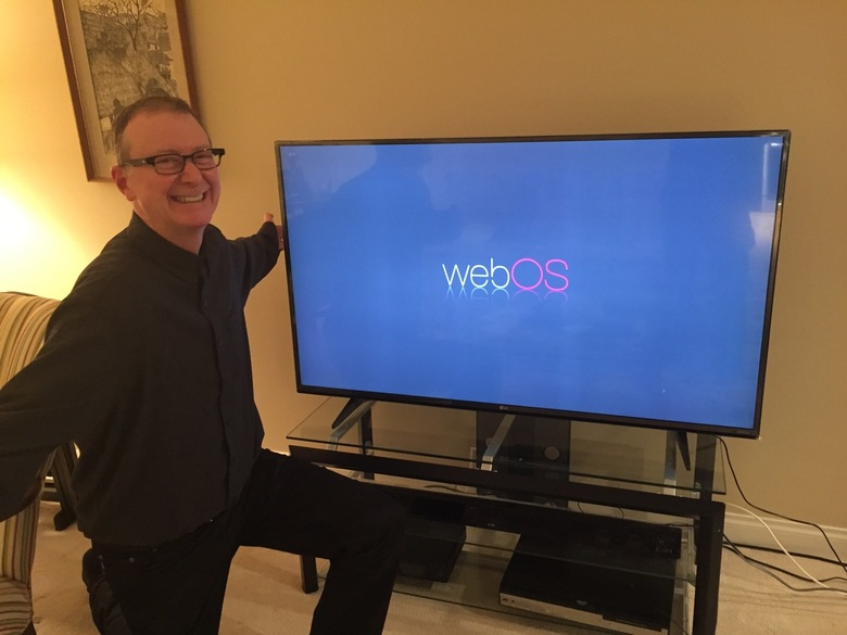 Jay admiring his new 55 TV birthday gift