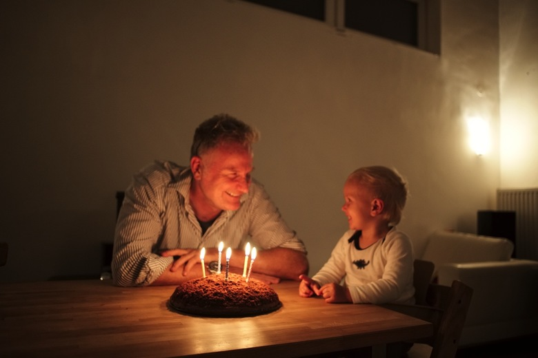 Constantin blowing out dads birthday candles
