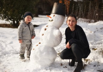 Constantin and his first snowman he built with Lucia