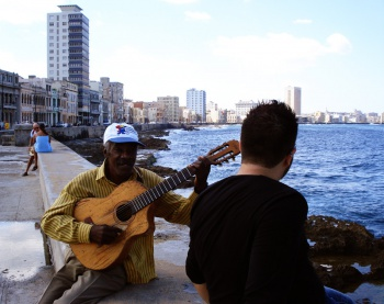 Cuban street musician asks Mark for song requests